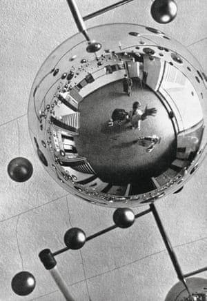 Walter Funkat: The lobby of the Bauhaus building, reflected in one of the glass spheres which decorated the buidling during the Metallic Festival, 1929.