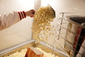 Employee Michelle Hutcheson scoops out hot popcorn