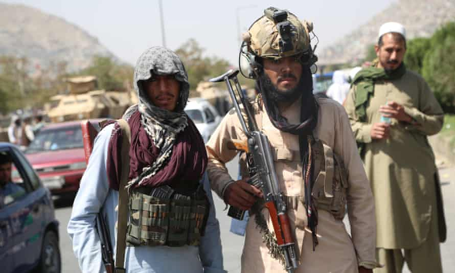 Taliban fighters stand guard in Kabul