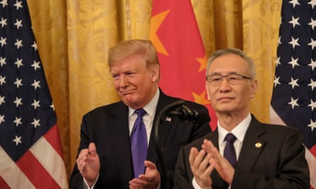 Donald Trump and Chinese vice premier Liu He applaud