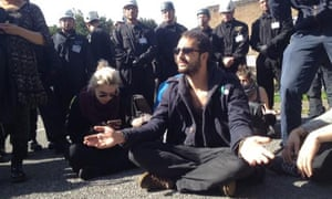 Face-off between squatters, supporters, police and enforcement officers at Sweets Way estate.