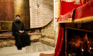 A clergyman sits in the Church of the Nativity in Bethlehem