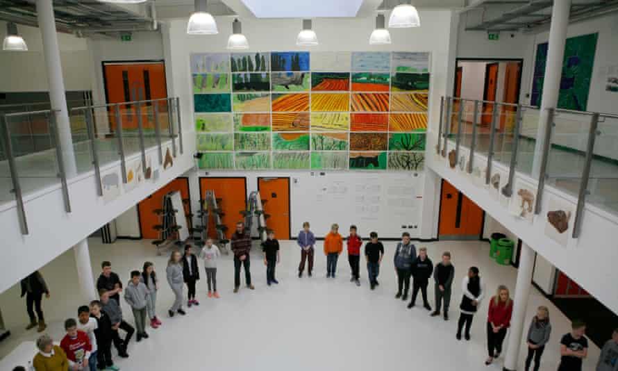 atrium of school with pupils