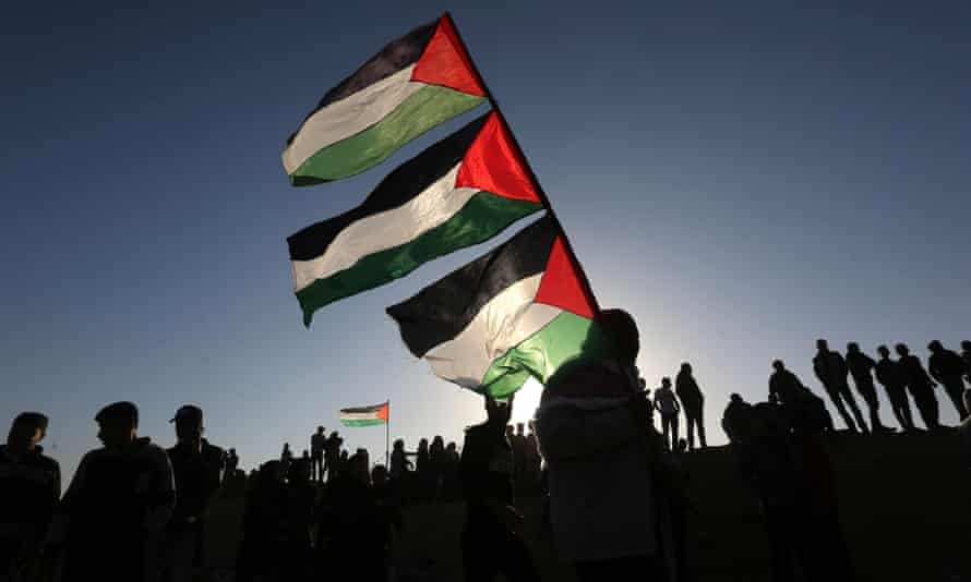 Palestinians attend the Great March of Return at the Israel-Gaza border on 12 April 2019
