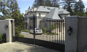 The front gate is shut at the mansion where Tiffany Li lives in Hillsborough, California.