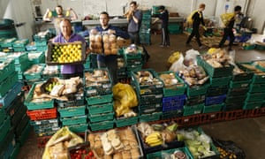 Keith Annal (front left) and other Real  Junk Food Project team members at its food rescue warehouse in Leed