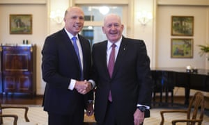 Peter Dutton shakes hands with governor-general Sir Peter Cosgrove after being sworn in as home affairs minister in Canberra on Monday.