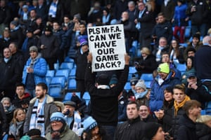 A supporter holds an anti-VAR placard during the match between Manchester City and Crystal Palace at the Etihad Stadium on Saturday.
