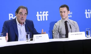 'There's more to it that meets the eye and whatever they tell you, you've got to look beyond,' said Oliver Stone, with Joseph Gordon-Levitt at the Toronto film festival, about the topic of his new drama Snowden.