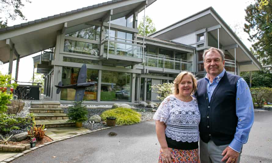 Mark and Sharon Beresford in front of their luxury property in Ringwood, Hampshire.
