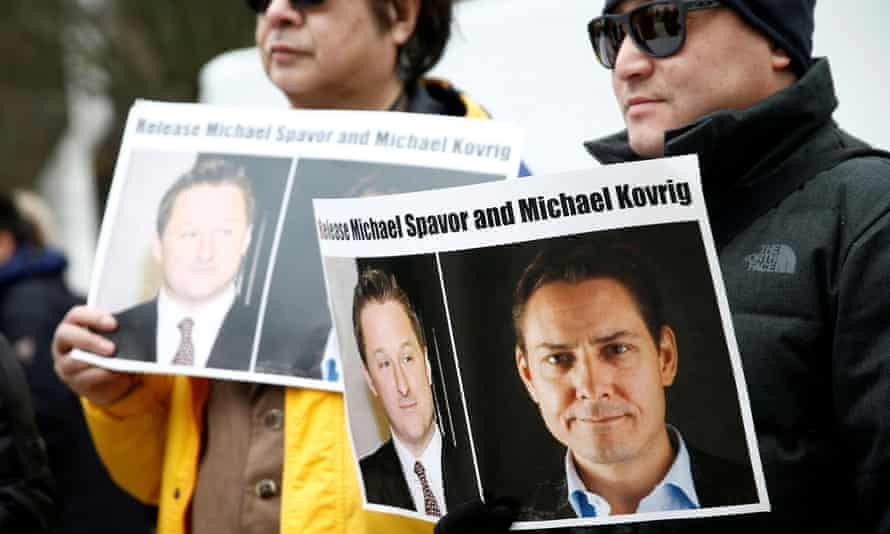 People hold signs calling for China to release Michael Kovrig and Michael Spavor in Vancouver, British Columbia, on 6 March 2019.