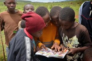 Children read educational comics as part of Kahumbu's Hands Off Our Elephants campaign