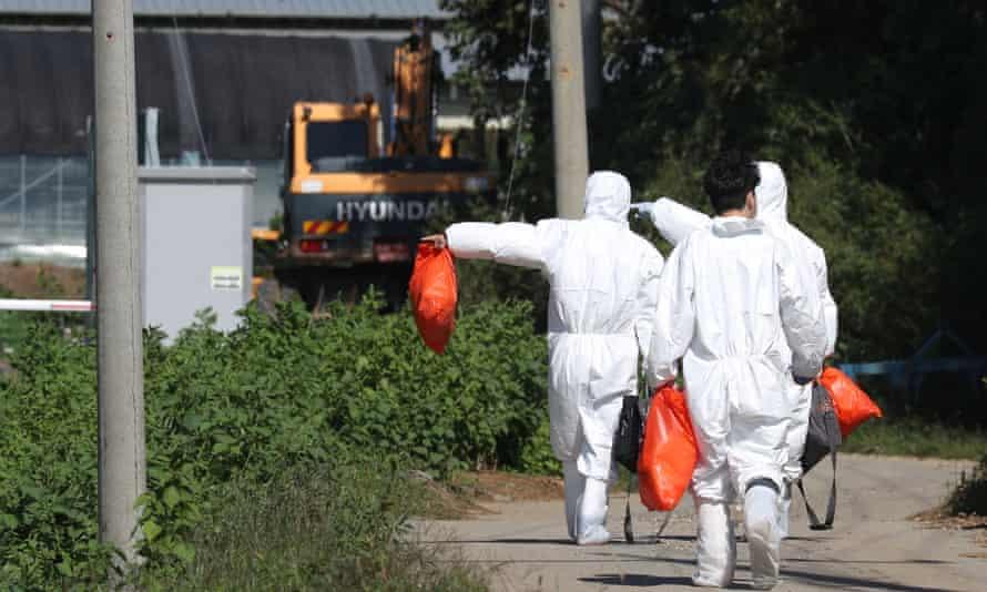 Quarantine officials inspect a pig farm in Yeoncheon, South Korea.