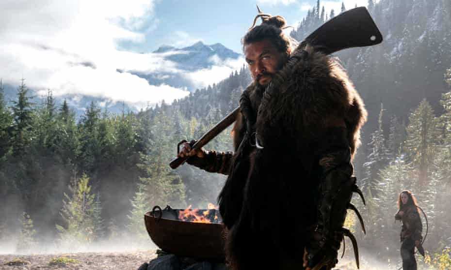 Nobody sports braids, scars and a viscera-flecked calfskin cape better ... Jason Momoa in See.