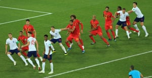 Players from both sides run in for the free-kick.
