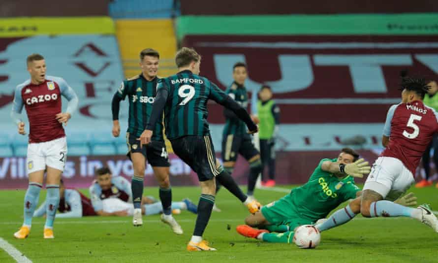 Patrick Bamford sweeps the opening goal past Emiliano Martínez.