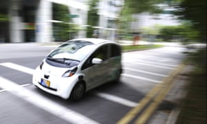 """A nuTonomy car vehicle out and about during a """"self-driving"""" taxi trial in Singapore."""
