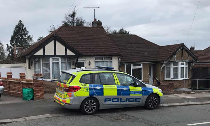 A police car outside the property in Ilford.