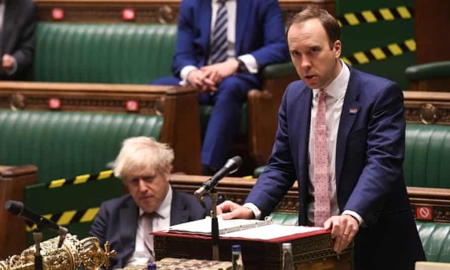 Boris Johnson listens as the health secretary, Matt Hancock, speaks in the House of Commons.