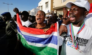 Supporters of president-elect Adama Barrow celebrate his inauguration at Gambia's embassy in Dakar, Senegal after President Yahya Jammeh, who has led the government for 23 years, refused to stand down.