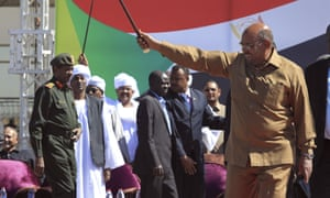 Omar al-Bashir greets supporters at a rally in Khartoum