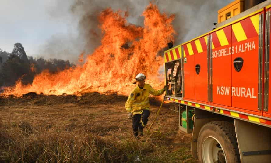 Firefighters are seen backburning and fighting fires in the northern NSW.