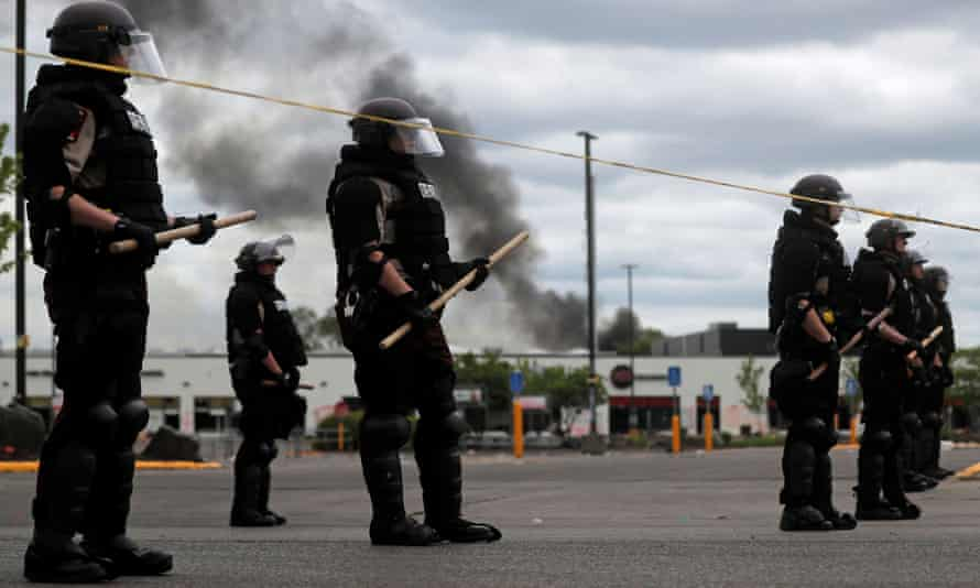 State patrol members guard at the area in the aftermath of a protest against the death George Floyd in Minneapolis police custody in Minneapolis, Minnesota, on 29 May 2020.
