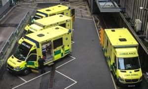 Ambulances wait outside the A&E unit at a hospital.