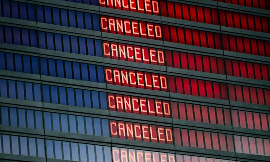 A flight information board displaying cancelled flights.