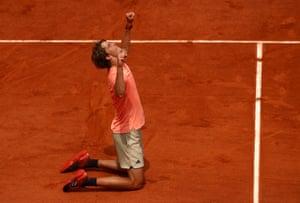 Zverev falls to his knees as he celebrates his win against Khachanov.