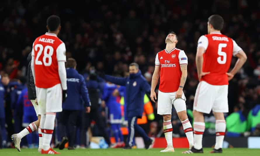 Granit Xhaka and his Arsenal teammates react after Youssef El Arabi's late strike.