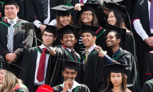 International students in traditional gowns and mortar boards at Aberystwyth University, Wales