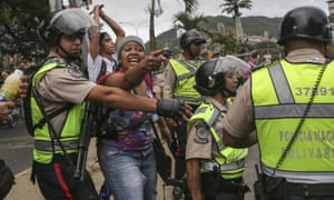 Police intercede with government sympathisers confronting opposition protesters in Caracas.