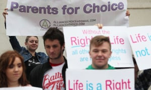 Pro-choice and anti-abortion protesters outside the Royal Courts of Justice in Belfast.