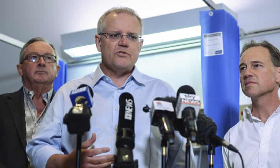 Scott Morrison (centre), Greg Hunt and NSW health minister Brad Hazzard (left) at Mount Druitt Hospital in Sydney last month.