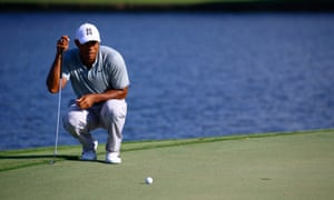 Tiger Woods lines up a putt during his second round