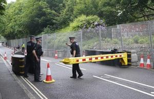 Police patrol a checkpoint near Tregenna Castle in Carbis Bay