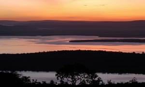 The sun rises over Lake Ihema in Akagera national park, Rwanda