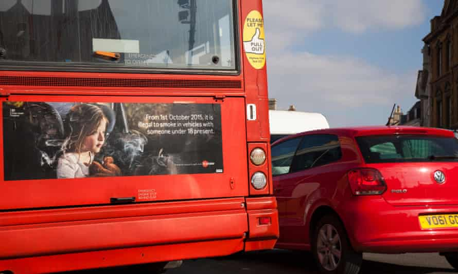 Red bus showing ad for smoking ban