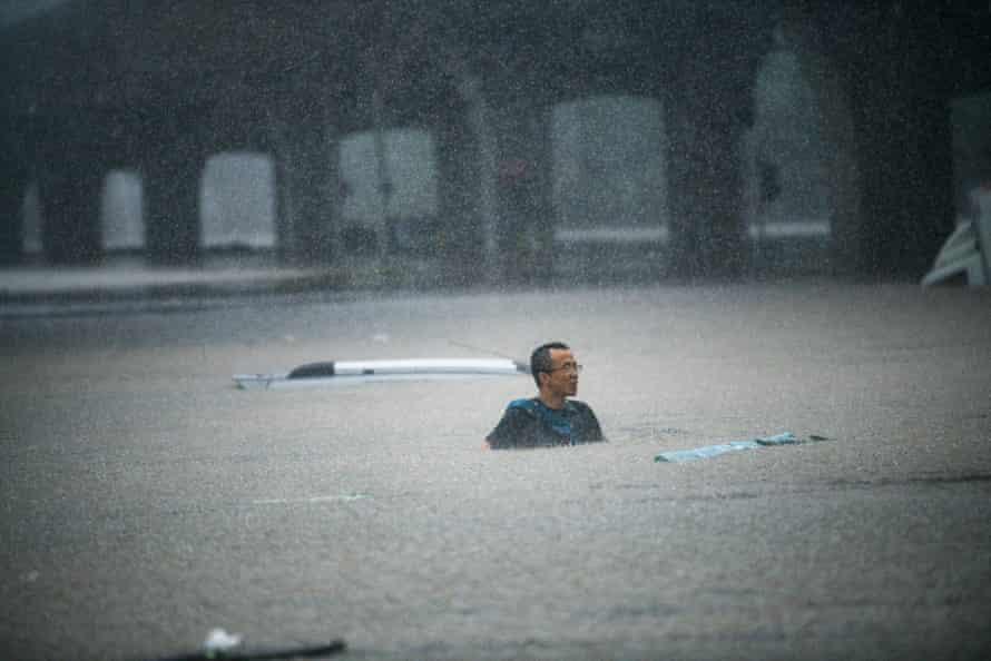People swim in floodwater in Zhengzhou