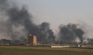 Smoke rises above the Syrian town of Tel Abyad