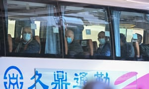Members of the WHO team leave their hotel after completing their quarantine in Wuhan, China.