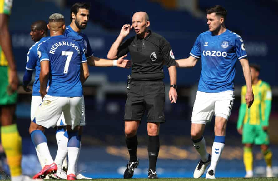 Everton's Andre Gomes, Michael Keane and Richarlison look on as Mike Dean awaits the conclusion of a VAR review before reinstating Dominic Calvert-Lewin's first goal at West Brom