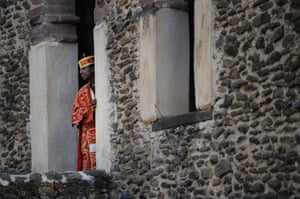 A trainee priest looks out from the tower at Fasilides Bath