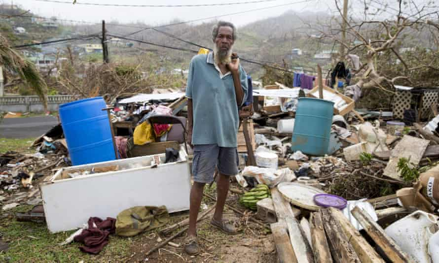 An 80-year-old man stands in front of his destroyed home in Marigot, Dominica, on 27 September.