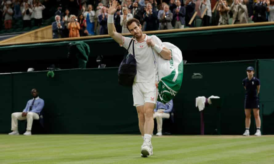 A defeated Andy Murray waves to the crowd as he walks off Centre Court