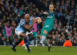 Manchester City's Vincent Kompany blocks a shot by Tottenham's Christian Eriksen.
