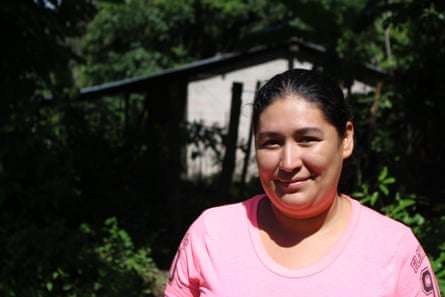 Betty Galvez, deported from the US and now living in the mountains of northern El Salvador, stands in front of her home