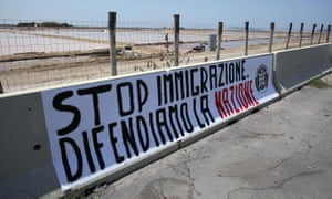 A banner reading 'Stop immigration, let's defend the nation' was placed by neo-fascist movement CasaPound at the port of Trapani, Sicily, in July.