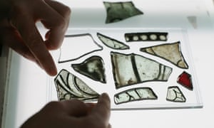 A conservationist works on shards of glass salvaged from the attics of Westminster Abbey.